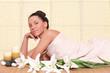 beautiful woman relaxing at spa