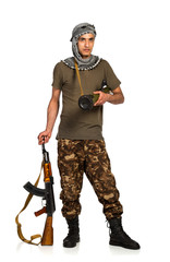 Terrorist with automatic gun and launcher on white background