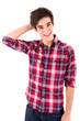 Young casual man posing isolated over white
