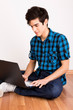 Young man working on computer laptop at home
