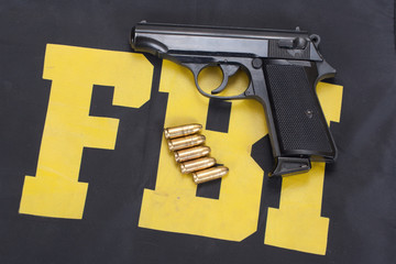 walter pp handgun on FBI uniform