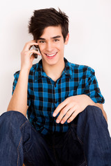Young man talking on the phone at home