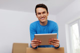 Happy man organize relocation in his new apartment poster