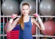 Beautiful woman in sportswear working out