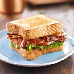 BLT bacon lettuce tomato sandwich on blue plate