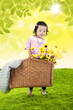 Girl bring basket of flowers