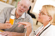 Doctor or Nurse Explaining Prescription Medicine to Senior Man