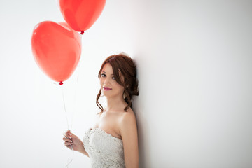Beautiful Bride Holding Balloons
