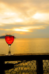 Red wine glass at sunset