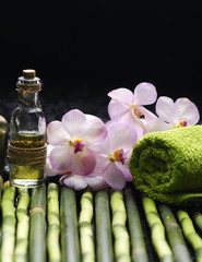Spa background with towels, bamboo grove and massage oil