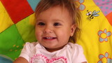 Face of funny adorable little girl with smile