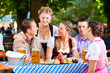 In Beer garden - friends on a table with beer