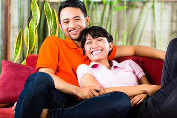 Asian couple at home