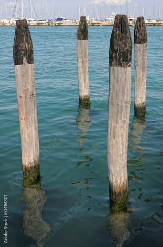 Wooden bollards in a nautical landing place