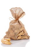 Raw potatoes in burlap bag