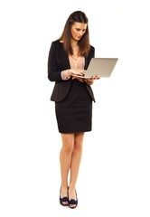 Woman in Copyspace Using Laptop