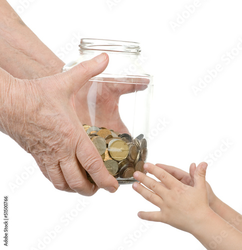 elderly person transfers to bank to hands of the child