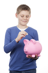 Cute boy saving money
