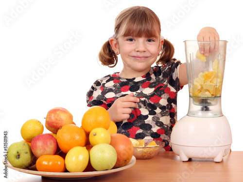 beautiful little girl make fruit juice