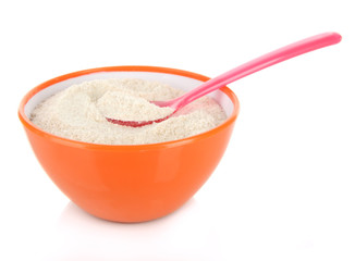 Powdered milk in bowl and spoon for baby isolated on white