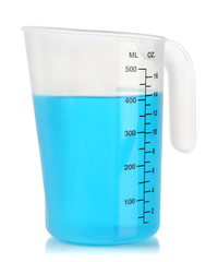 Measuring cup with blue liquid isolated on white
