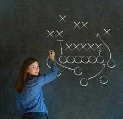 Woman with American football strategy on blackboard