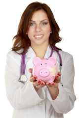 A doctor holding piggy box with a stethoscope, close-up