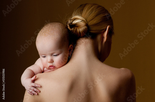 young mother holding a baby in her arms