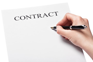 hand with pen signing a contract