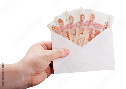 hand holding an envelope with rubles