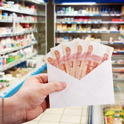 hand with rubles in the envelope