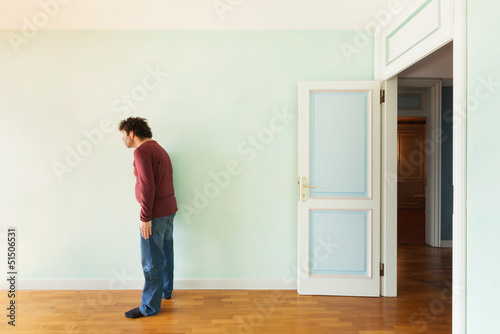 portrait of a weird guy in the room with the door open