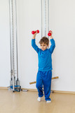 Child is therapeutic exercises in the gym poster