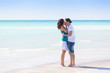 Young Couple Embraced in a Caribbean Beach