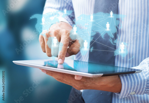 businessman using tablet and social network as concept