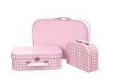 stack of three suitcases, pink with white dots , isolated on whi