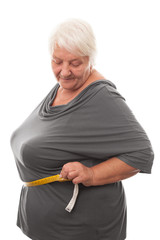 fat woman measuring waist