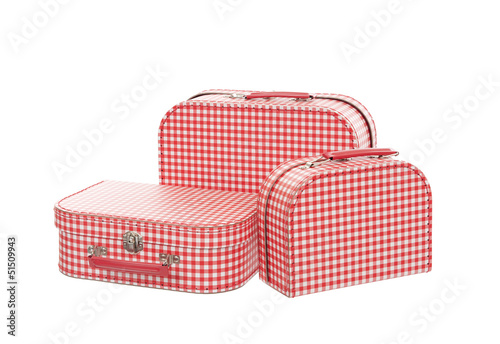 three vintage red and white suitcases, isolated