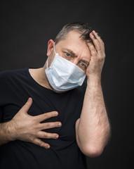 sick old man in medical mask