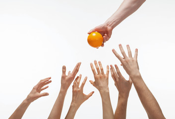Many hands want to get orange