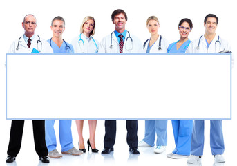 Group of medical doctors with banner.