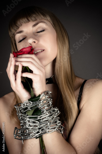 sensual woman with a rose in hand