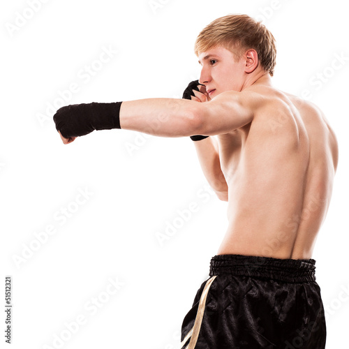 Young handsome fighter in shorts