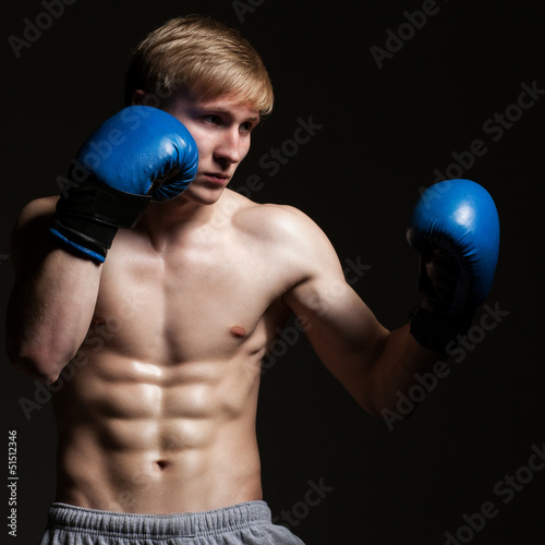 Young handsome boxer in a movement