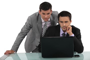 Business associates reading a distressing e-mail