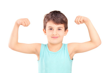 A kid showing his muscles