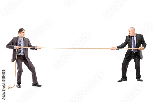Full length portrait of two businessmen pulling a rope