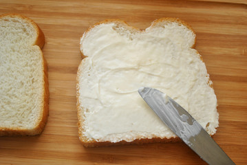 Speading Mayo on White Bread