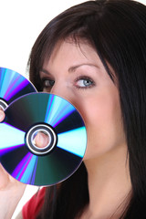 Woman holding up CDs