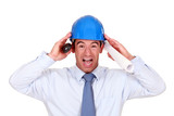 businessman with a helmet having a headache
